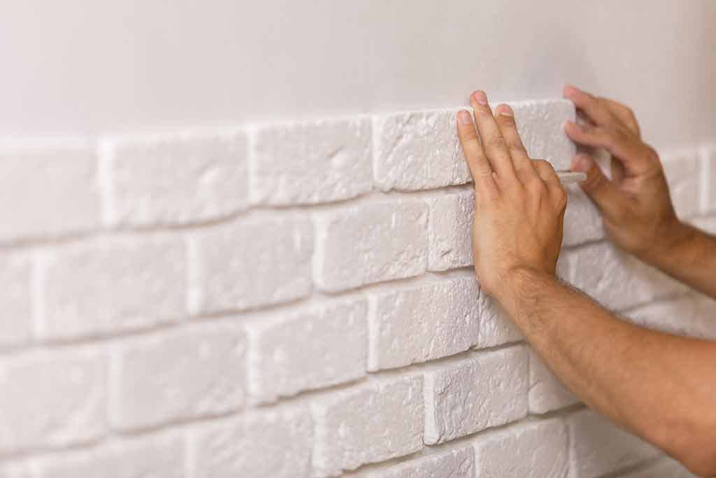 The walls must be prepared well before installing the stone to ensure its safety and avoid problems